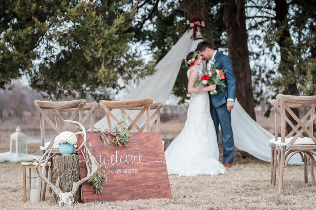 A rustic lakeside wedding inspiration shoot with an Airstream, vintage furniture and a palette of rich reds, purples and gold by Amanda Zabrocki Photography