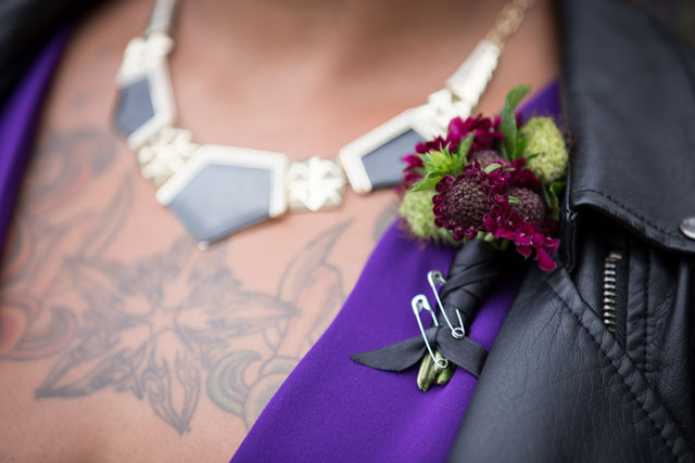 An edgy, provocative and chic same sex styled shoot featuring tattoos, motorcycles and a gold spiked black cake | Amy Sims, Photographer: http://www.amysimsphotographer.com