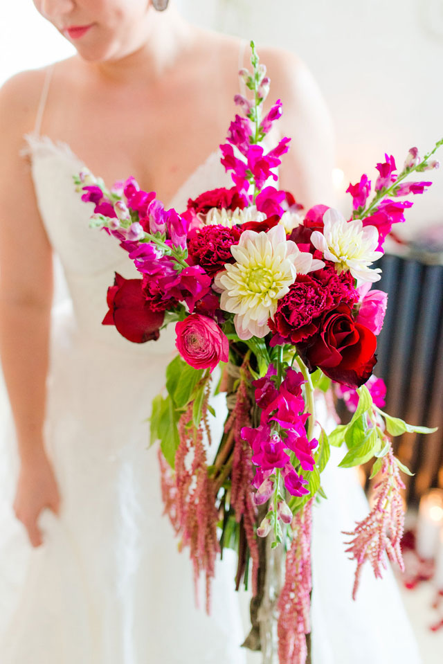 A bold and beautiful Charm in the City wedding inspiration shoot with a vibrant palette of red, gold and black with pops of pink by Ashton Kelley Photography