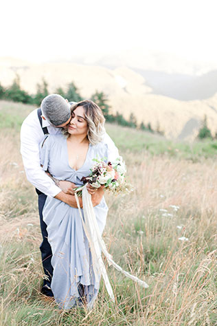 A simple yet stunning mountaintop styled elopement with lush floral designs and fresh fruit by When She Knew Photography