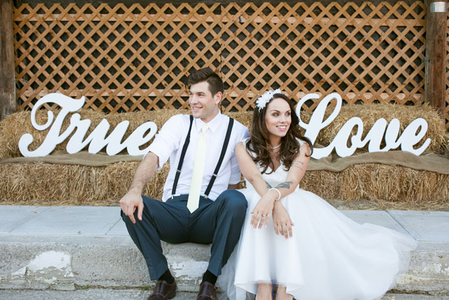 A rustic blue and yellow lemonade wedding inspiration shoot with a custom lemonade stand // photo by Christine Picheca Photography: http://christinepicheca.com || see more on https://blog.nearlynewlywed.com