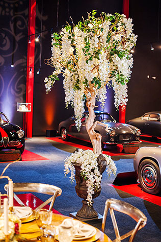 A glamorous old Hollywood inspired styled shoot in a vintage car museum by Drew Brashler Photography and Your Jubilee