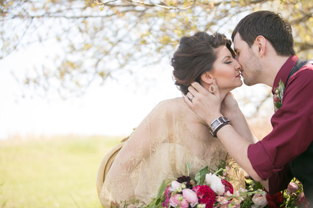 An enchanting lost in the woods styled shoot at Bloom Lake Barn with gorgeous floral designs and a rich red palette by Erin Johnson Photography
