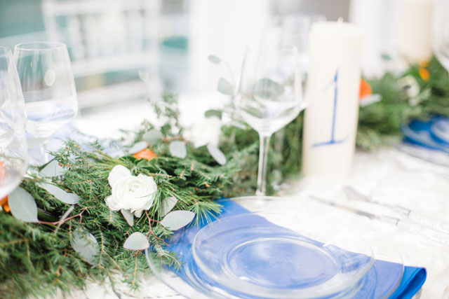 A modern winter wedding inspiration shoot with a palette of soft winter whites and bold pops of citrus and deep winter tones by For the Love Photography