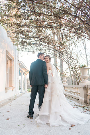 A romantic Christmas wedding inspiration shoot with a sweetheart table, cranberry cocktails, winter greenery and fur stockings by Hana Gonzalez Photography