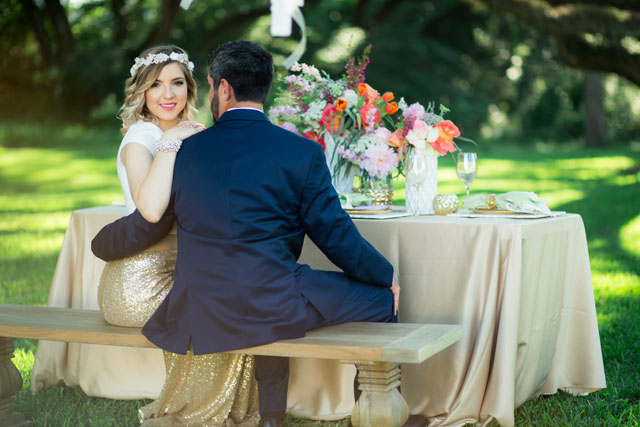 A chic boho watercolor wedding styled shoot in Texas with vibrant florals and a gold two-piece wedding dress by Jessica Pledger Photography
