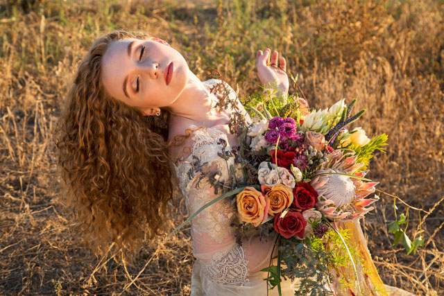 A sun-kissed golden hour bridal inspiration shoot with a coppery dress and protea bouquet | Kelsey Fugere: http://www.kelseyfugere.com | Diana Sabb Events & Designs: http://www.dianasabb.com