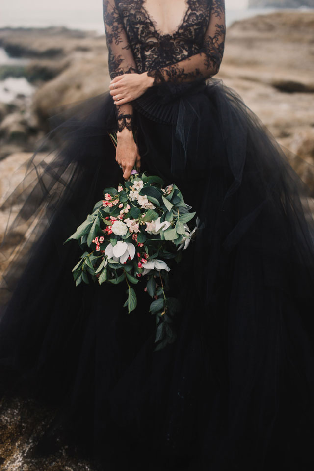A moody coastal elopement on Cape Kiwanda with a black lace dress and waves crashing in the background by Mari Sabra Photography and Rose & Stone