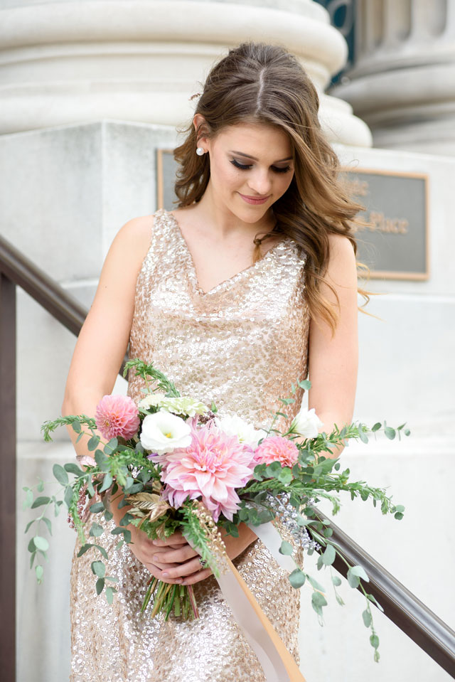 A golden, metallic library wedding inspiration shoot at the George Peabody Library with a stunning cake and floral table arch by Michelle Lynn Weddings