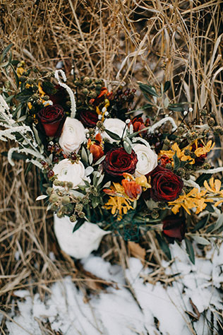 A moody and rich Chronicles of Narnia themed elopement shoot with a stunning tablescape by Photography by Kelsey Rae and Jade & Joy Events