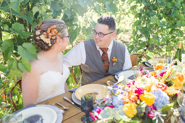 A Pennsylvania wedding styled shoot featuring a colorful table amongst the lush vines at Grovedale Winery by Seneca Ryan Co. and Forget-Me-Not Rentals