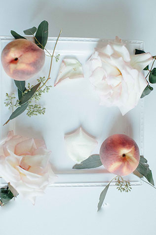 An enchanted peche (peach) wedding styled shoot with a warm spring palette of blush, peach and green by Poetry and Paper