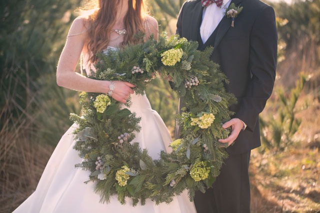 A Christmas wedding inspiration shoot with vintage details, a traditional palette of red and green, and signage with calligraphy by Shelby Photography