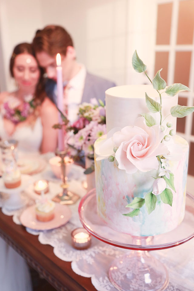 A whimsical styled unicorn elopement with a pastel rainbow palette and adorable desserts by Sisi Photo