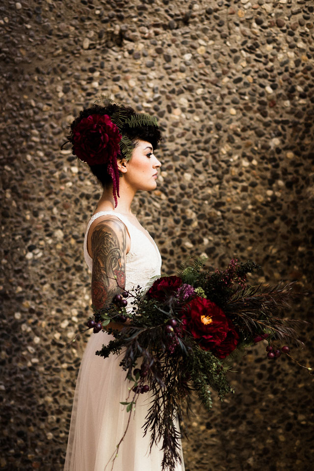 Blending all things boho, bold and moody tones, this wedding inspiration shoot features a floral shrug, a luxe tablescape and more by Tandem Tree Photography and Acowsay Cinema