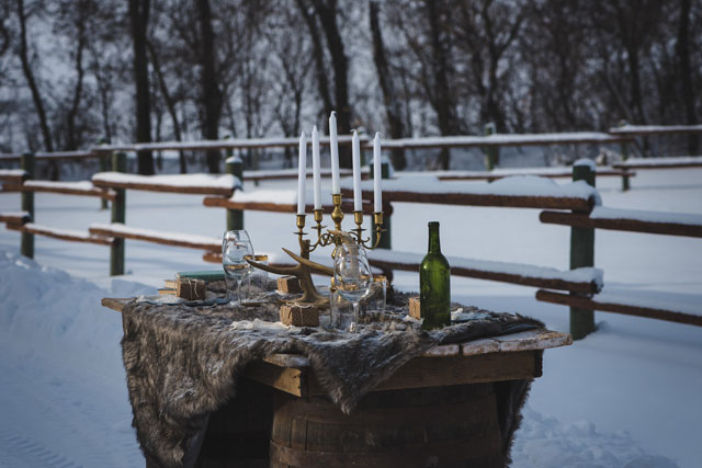 A marsala-hued snowy, dreamy winter wedding inspiration shoot at a rustic ranch by The Winnipeg Wedding Photographers Collective and Melanie Parent Events