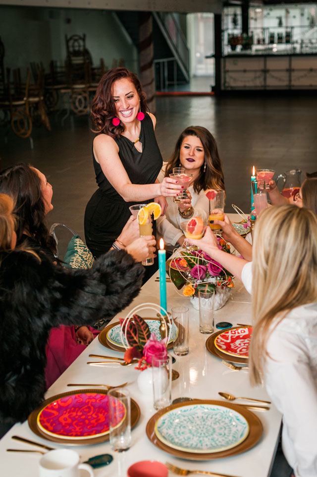 A vibrant and modern citrus-hued Galentine's Day dinner party with a signature cocktail by Choice Jade Photography and Saving Grace Occasions