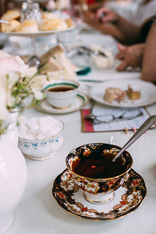 A high tea bridal shower with delicious finger foods and teapot centerpiece | Sara Lynn Paige: http://saralynnpaige.com