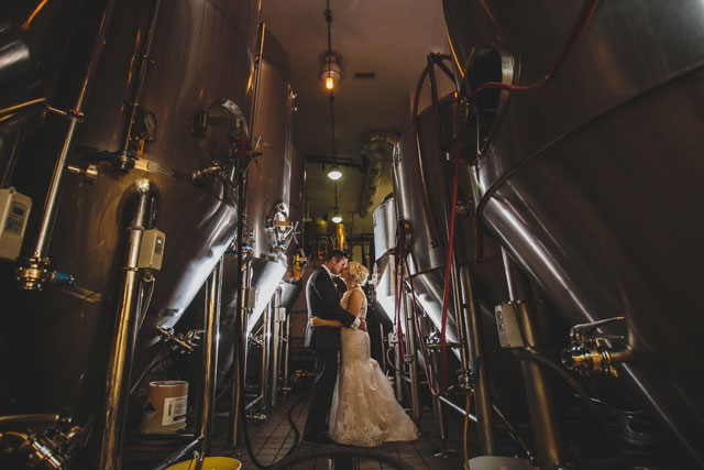 A creative Chicago brewery wedding with a gray color palette and succulent bouquets by Angela Renée Photography