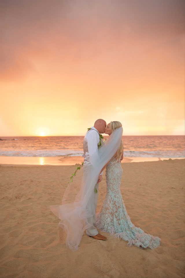 A lavish Maui destination wedding including a helicopter ride, orchids and a vibrant tropical color palette by Anna Kim Photography