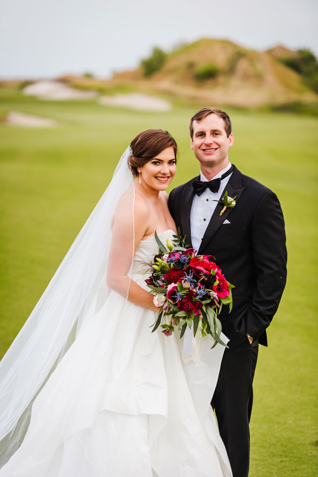 A sophisticated Streamsong Resort wedding with a beautiful palette of burgundy, navy and gold by Ashlee Hamon Photography