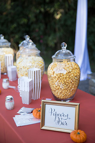 A pumpkin themed autumn wedding with a s'mores bar and a popcorn bar by Ava Moore Photography