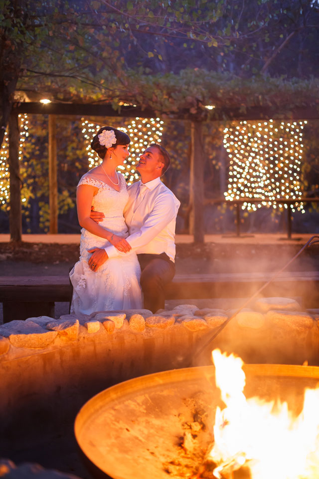 A rustic autumn River Ridge Ranch wedding with sunflowers and a fire pit by Bergreen Photography