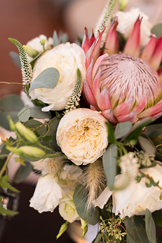 A whimsical Harry Potter wedding at the Historic Post Office with rose gold details, king protea bouquets and fanciful lighting by Caitlin Gerres Photography