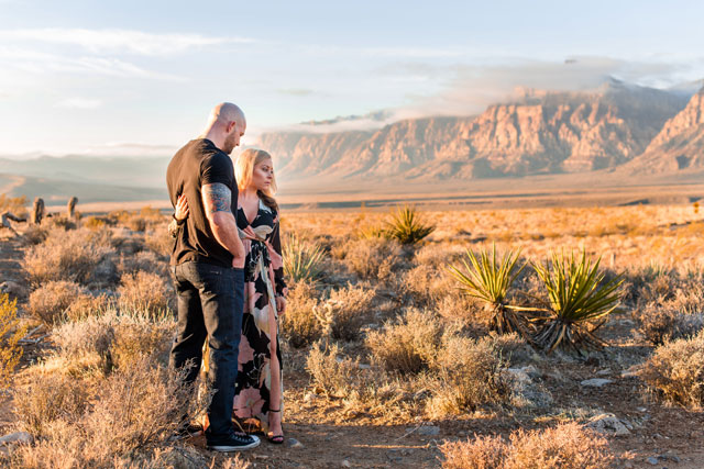 An intimate and romantic sunrise couple's session in Red Rock Canyon by Caroline & Evan Photography