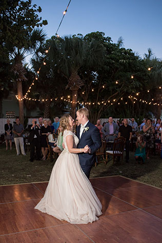 A beautiful, rustic beachside Siesta Key wedding with vintage furniture, a s'mores station and a dance floor under the stars by Cat Pennenga Photography