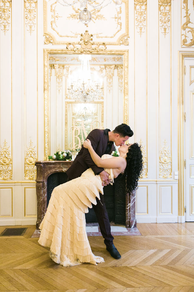 A luxe Christmas elopement in Paris with champagne and his and hers Christmas stockings by Catherine O'Hara and Fête in France