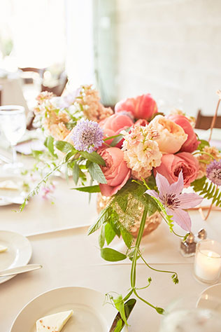 A fun and bohemian summer Chicago rooftop wedding with a light pastel palette by Coach House Pictures