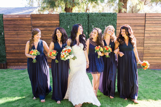 A traditional yet modern multicultural backyard estate wedding with a colorful palette of navy, coral and marigold by Dan & Erin PhotoCinema