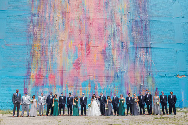 A multicultural Eastern Market wedding in Detroit with a macaron cake and a green and white color palette by E Schmidt Photography