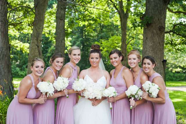 An elegant pink and white summer backyard barbecue wedding with a tented reception in Illinois by Elite Photo
