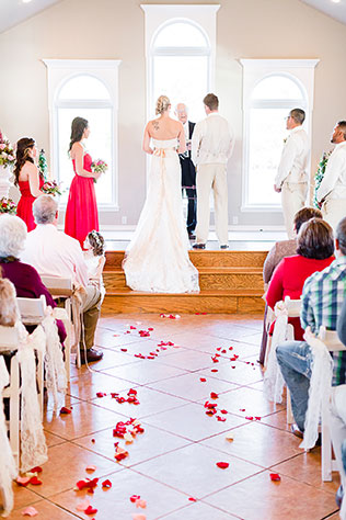 A breathtaking winter wedding in Oklahoma with vibrant scarlet details | Fleckography Co.: http://www.fleckography.com