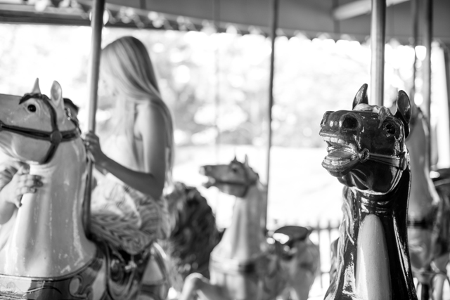 A playful carousel engagement session at Toronto Island Amusement Park // photos by GreenAutumn Photography: http://www.greenautumn.ca || see more on https://blog.nearlynewlywed.com