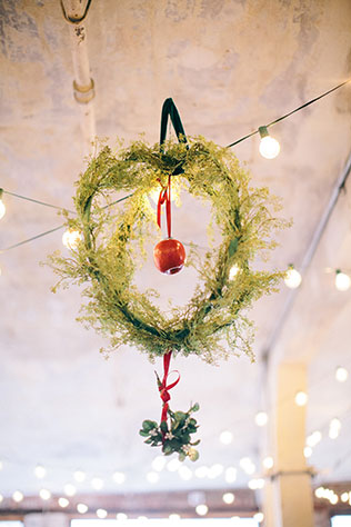 An urban Victorian winter wedding with velvet, jewel-toned fruits, mistletoe and twinkling lights by Her Song Photographs