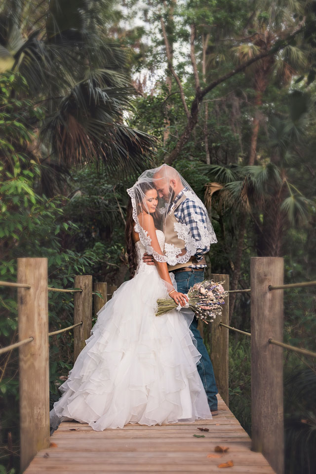 A fabulously elegant and vintage farm wedding in Florida with horses and an outdoor ceremony by Jamie Reinhart Photography