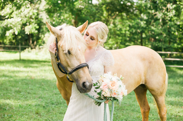 A romantic vintage equestrian wedding with a palette of cream, peach and powder blue by Jennifer Green Photography