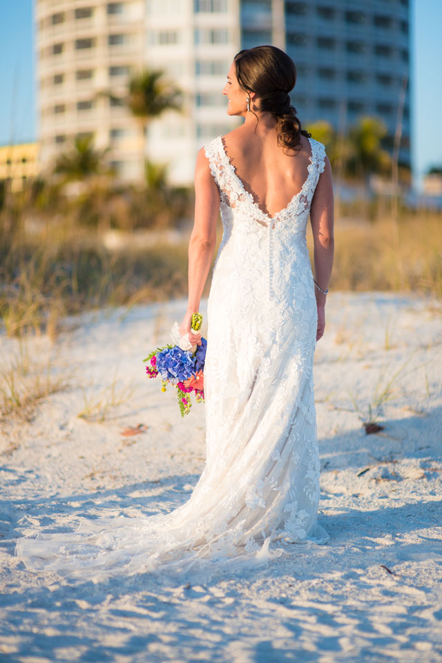 A lovely springtime watercolor beach wedding in Florida in ocean shades of blue and green by Kera Photography