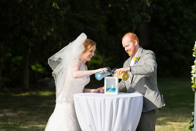 A sweet summer wedding with a blue and yellow lovebird theme // photos by Lindsay Fauver Photography: http://www.LindsayFauverPhotography.com || see more on https://blog.nearlynewlywed.com
