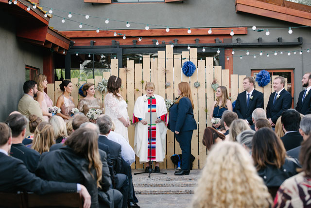 A sunny winter same sex Palm Springs destination wedding with a palette of indigo and rose gold by Liz Daino Photography