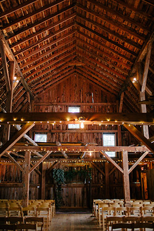 A rustic and boho chic rainy day wedding with macrame chandeliers and custom wood signage by Maiko Media and Oak & Honey Events