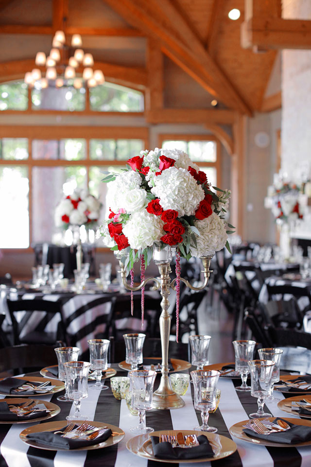 An intimate black and white striped wedding at Lake Tyler Petroleum Club with pops of vibrant red by Photography by Gema