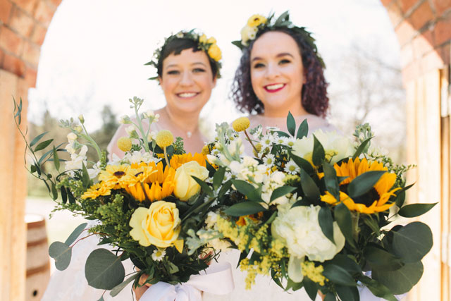 A beautiful and rustic Sassafras Springs Vineyard wedding with sunflowers by Prairie to Pacific and Most Joyful Day