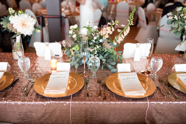 A romantic fall Minnesota wedding with rustic details, greenery and a muted feminine palette of blush, rose gold and ivory by Schrage Photography
