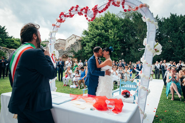 A fabulously fun and quirky wedding in Wonderland in Italy with a Mad Hatter's tea table, flamingo croquet and Caterpillar's hookah by Selene Pozzer