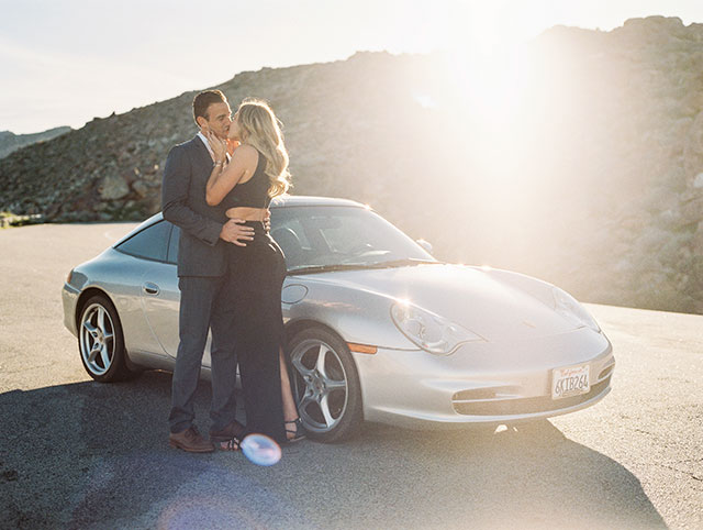 A James Bond inspired desert escape engagement session with a Porsche and a dry lake bed by Taylor Abeel Photography