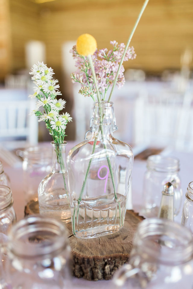 A light and airy Plantation Oaks Farm wedding with rustic details and a gorgeous purple and green palette by The Copper Lens Photography Co.